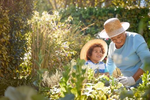 Grandma and grandson in garden